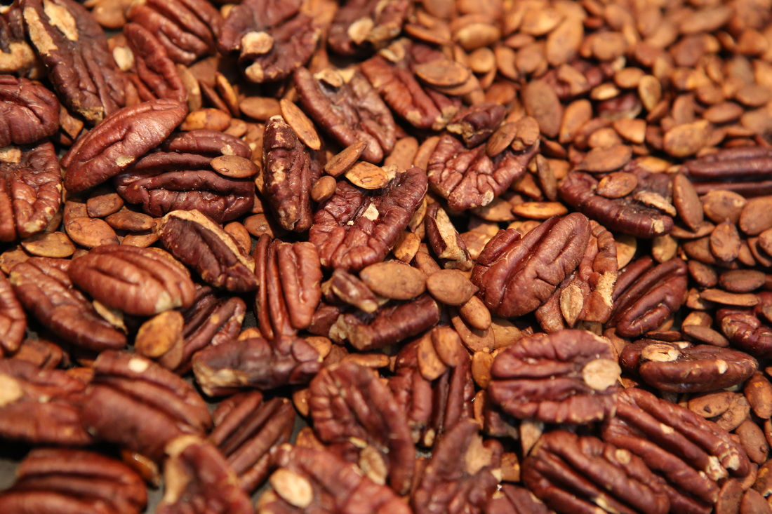 of your oven and preheat to 350F. spread pecans and pumpkin seeds ...